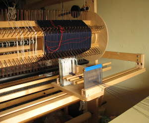 Warping the sectional warp beam